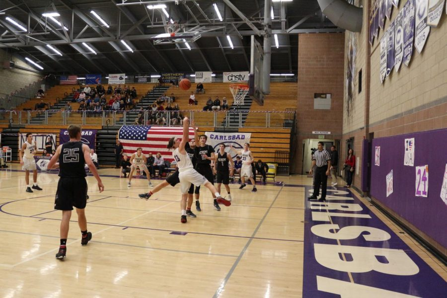 Junior Gavin Schmidt charges into the paint for two points. Carlsbad defeats CCA with a 61-59 victory.
