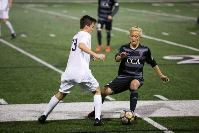Senior Todd Premore dribbles up the field and challenges the CCA defender in the Boys Varsity Soccer game Feb. 2, 2018. Carlsbad ended with a 2-2.