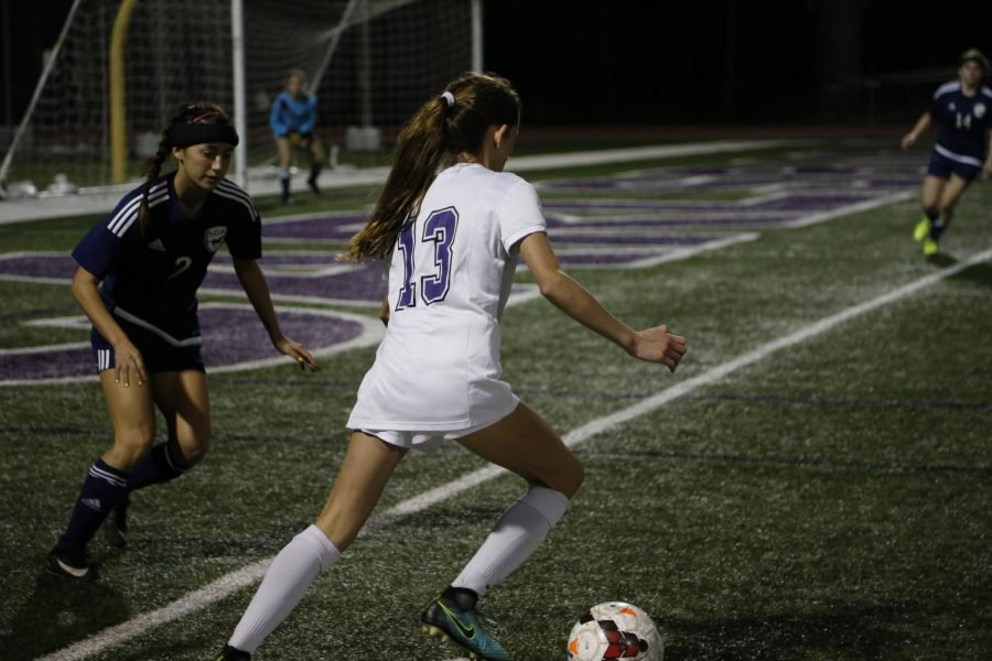 Freshman Lexi Wright kicks the ball in hopes for a goal. The game ended with 1-0 CHS in the lead with opponents of SDA.