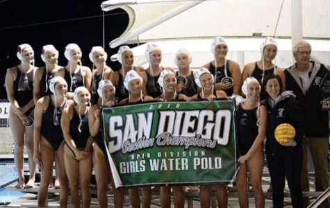 Women's water polo gathers for a picture documenting their championship victory.