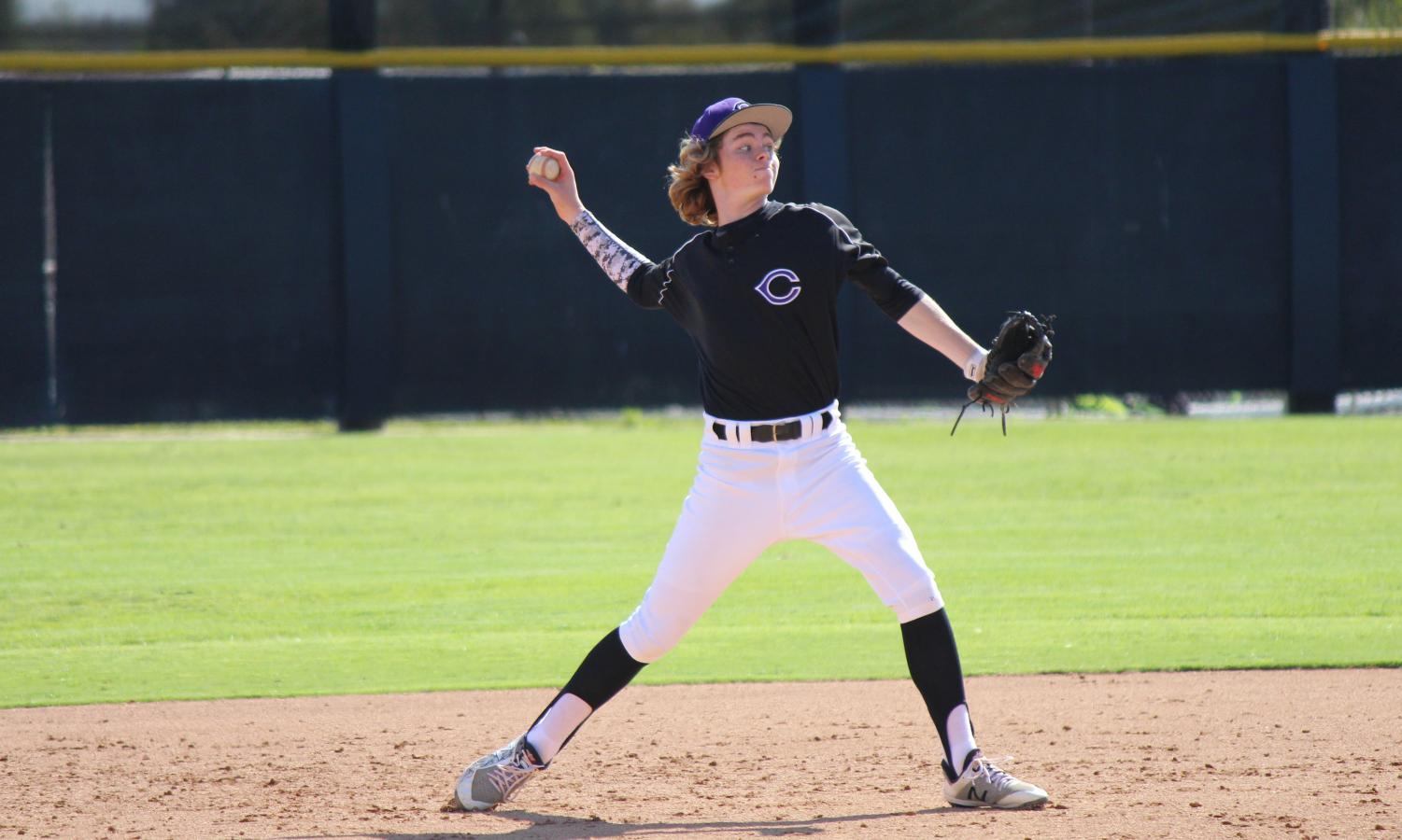 Freshman Konrad Bohnert throws the ball to first base in hopes for an out. The JV team played Rancho Bernardo and lost six to four.