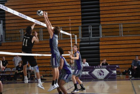 Senior Kaden Rutherford blocks a Pacific Ridge attempt to score a point. The Lancers won in three games over the Firebirds.