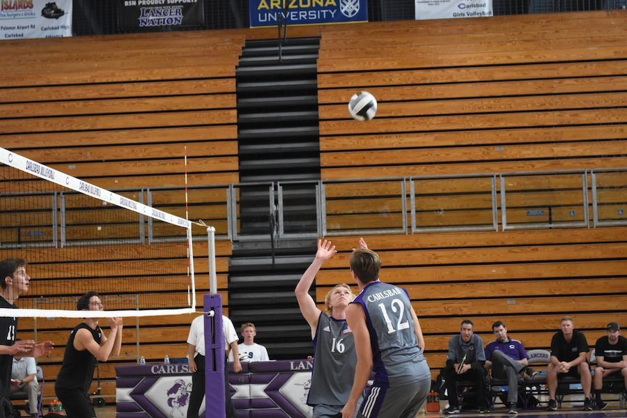 Sophomore+Thomas+Capps+sets+his+teammate+in+the+game+against+Pac+Ridge.+The+Lancers+won+in+three+sets+to+the+Firebirds.