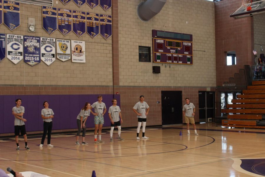 Senior Wyatt Andrews looks to throw the ball to the opposing dodgeball team. Wyatt Andrews was the last man standing on his team for both rounds.