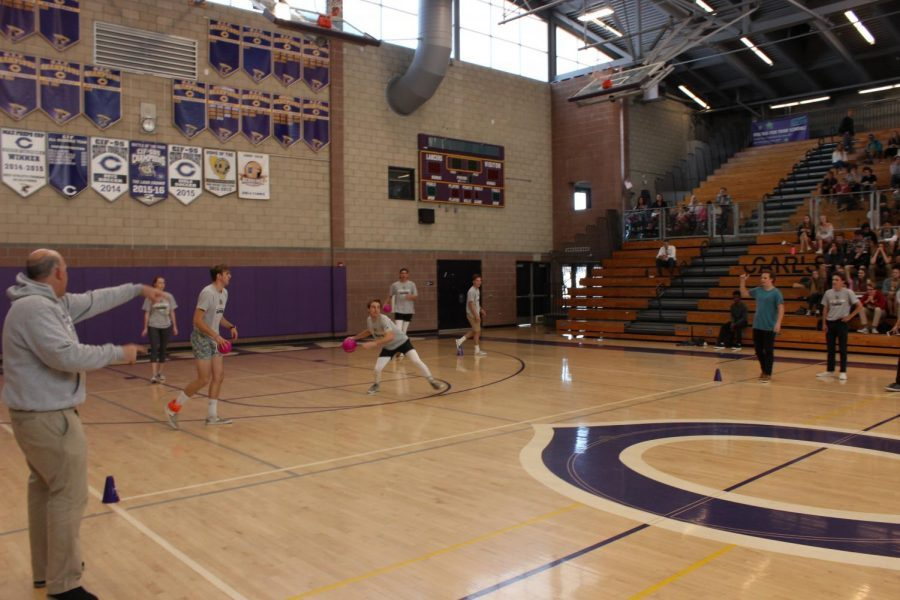 Senior+Wyatt+Andrews+looks+to+throw+the+ball+to+the+opposing+dodgeball+team.+Wyatt+Andrews+was+the+last+man+standing+on+his+team+for+both+rounds.