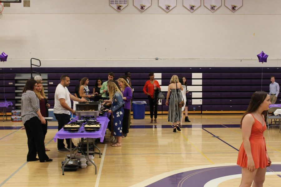 Speech and debate students get in line before the ceremony begins. Both parents and team members were able to partake in the food.
