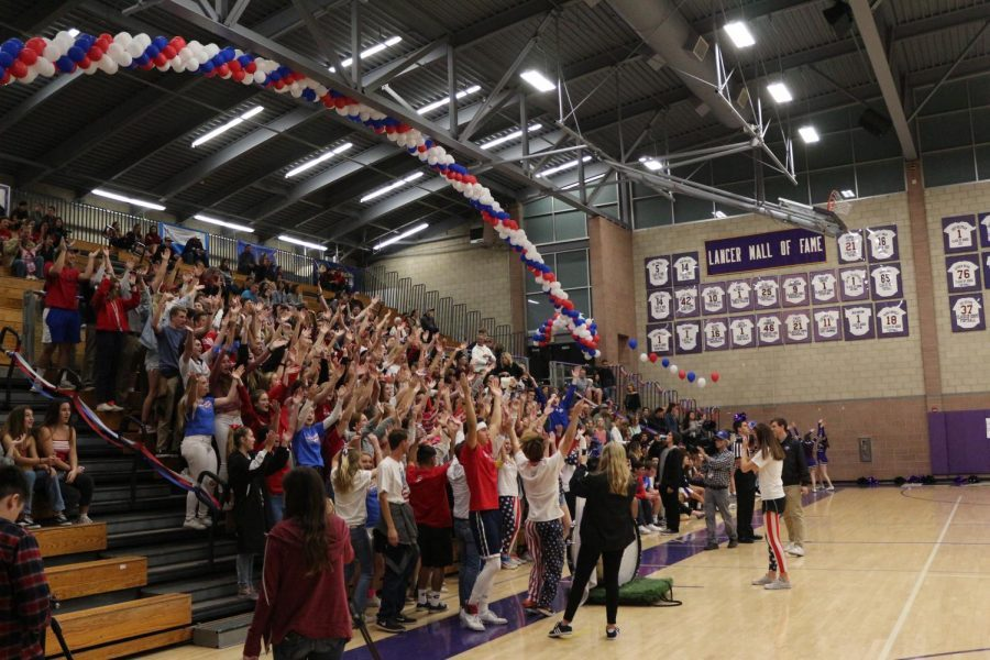 Carlsbad High School loud crowd dresses up in patriotic attire for the varsity basketball game against Canyon Crest Academy. CIF came to judge Carlsbad's school spirit, in order to compete in