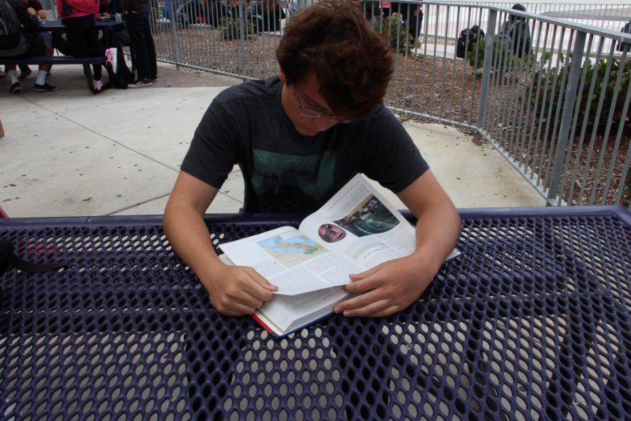 Sophomore Spencer Stabile-Bell studies for the AP European History exam at lunch. The test was held at the Del Mar Fairgrounds on May 18.