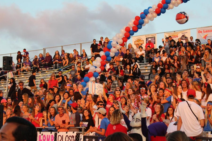 Loud crowd begins to cheer on the varsity football team in their USA themed game against Mission Hills, Friday, Sept. 15.