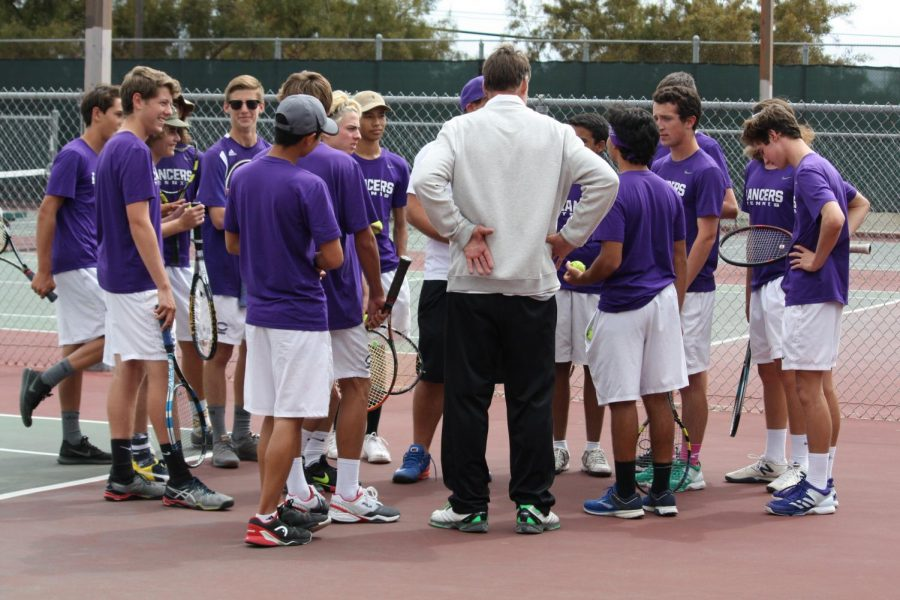 Varsity+Coach+Clayton+and+Junior+Varsity+Coach+Ed+talk+to+the+Varsity+Boys+Tennis+team+pregame.+Carlsbad+High+played+Ramona+High+School+in+the+CIF+quarterfinals+Wednesday%2C+May+2.+The+Lancers+went+on+to+beat+Ramona.+The+next+day%2C+Thursday%2C+May+3+the+Lancers+beat+Sweetwater+in+the+semifinals+to+move+on+to+the+CIF+final+Friday+at+Balboa+Tennis+Complex.