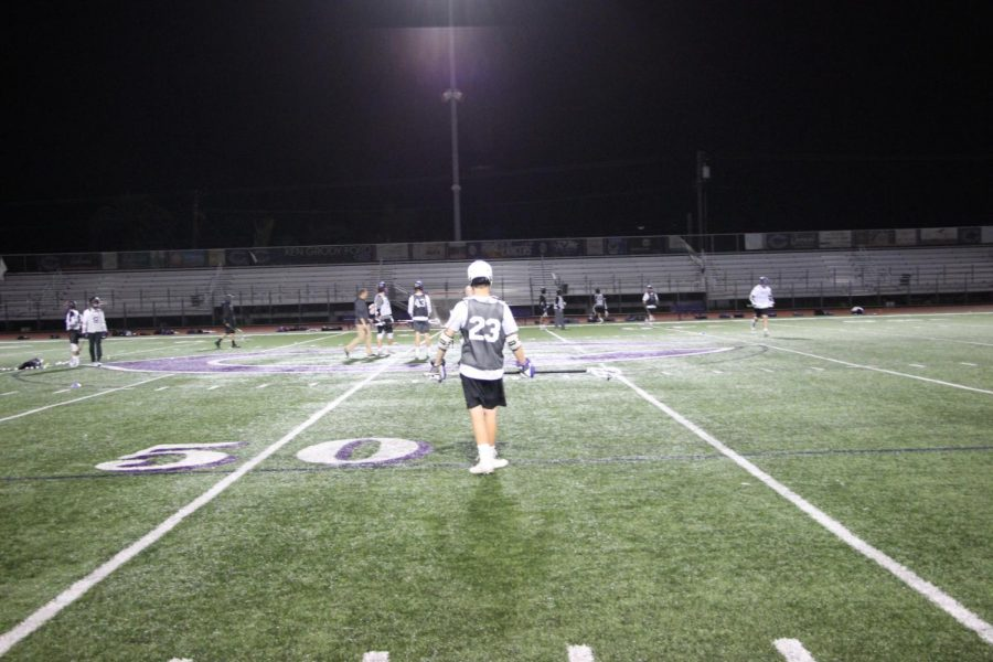 Sophomore Edward Gardner lines up on the restraining box to get ready for the seniors to face off and start the drill. The mens lacrosse team has been working hard to secure their spot in open division CIF.