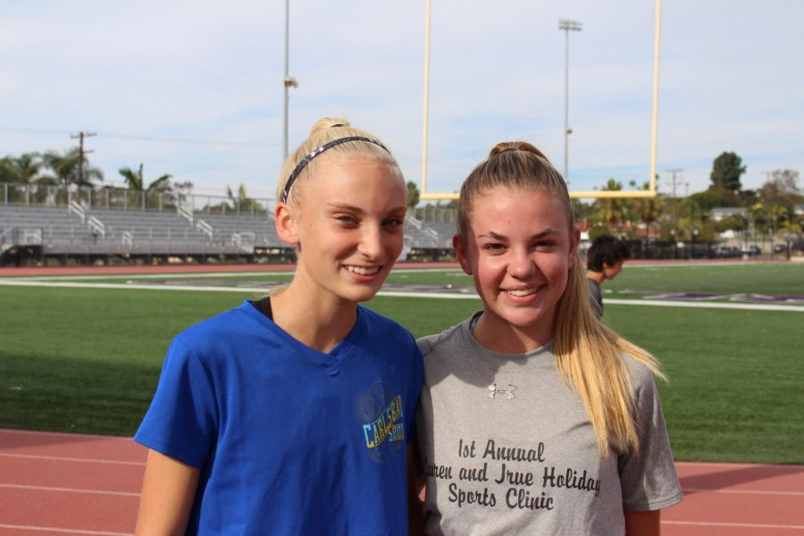 Freshman Hailey Large and freshman Morgan Young are about to start their cross country practice. Young and Large both made varsity cross country.