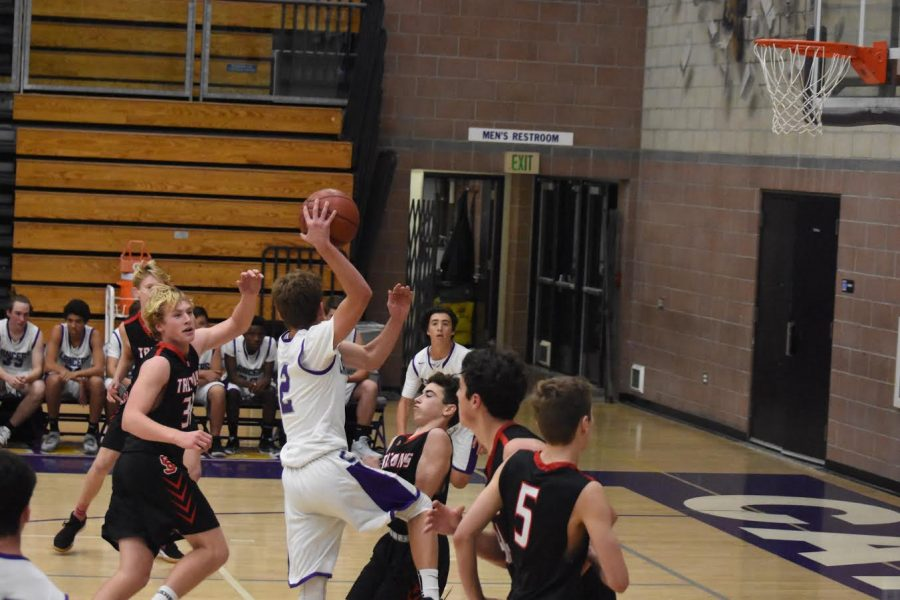 Junior Jack Geraghty drives to the basket, looking for the pass to sophomore Sam Hasegawa. The boys junior varsity team was playing against San Clemente High School.