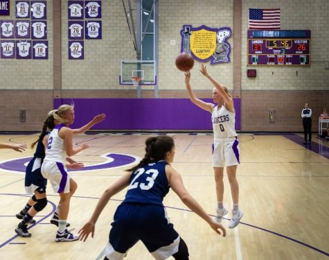 Freshman Alexa Mikeska goes up for the jump shot. Mikeska is averaging 8.6 points per game 10 games into the season.