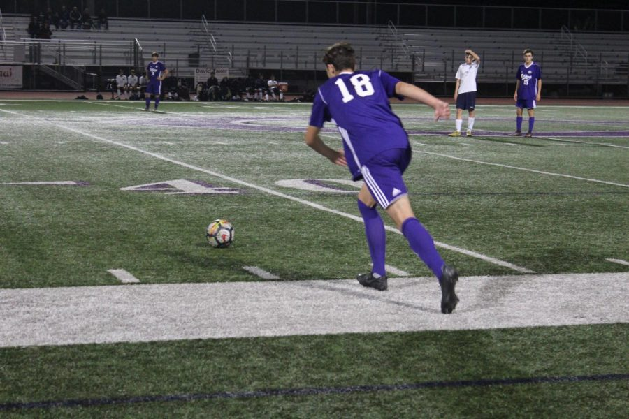 Sophomore Joe Totoris lines up for a kick. Lancers won the game with a score of 1-0.