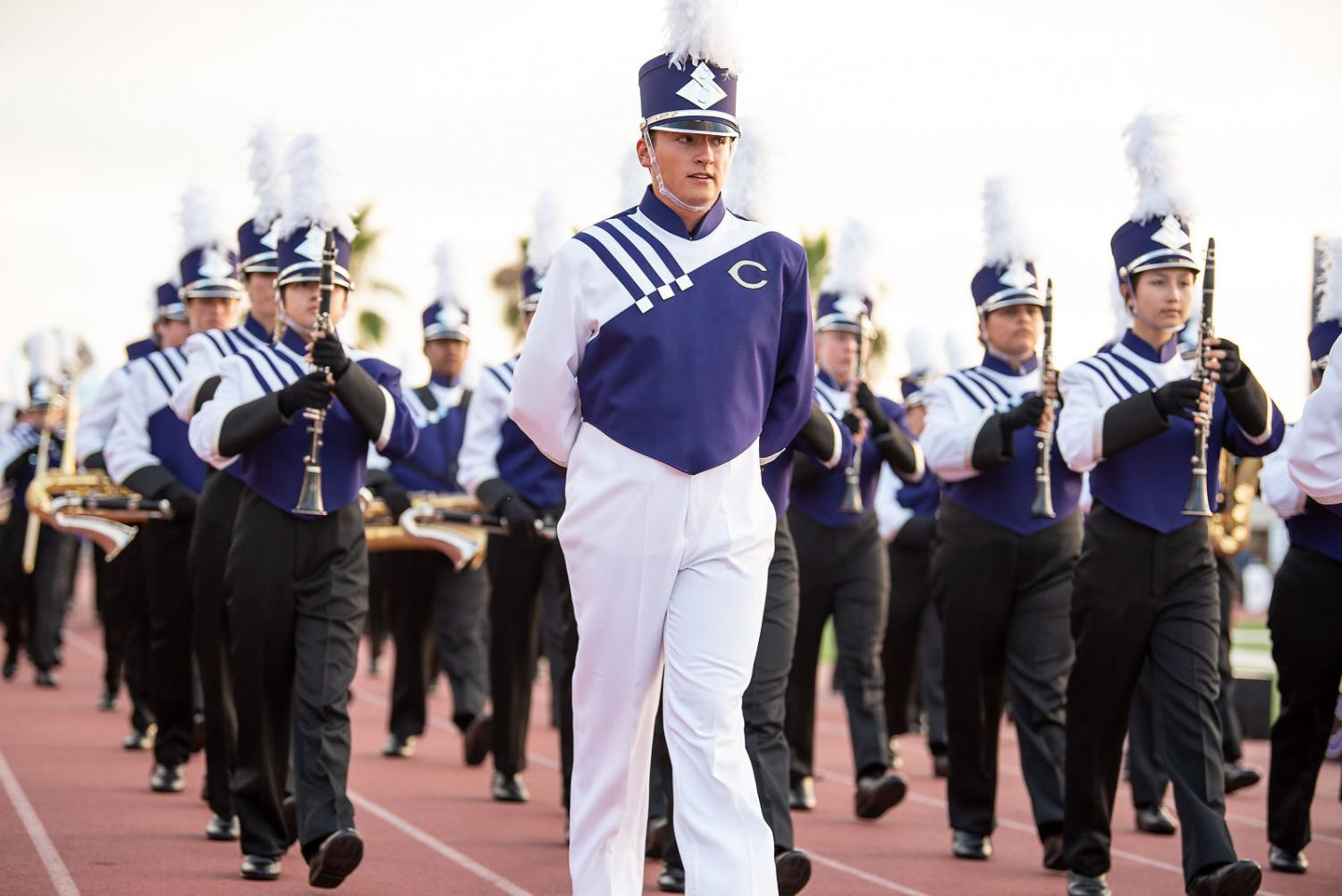 Ethan Prom, a band conductor at CHS, leads the band at different events and competitions.