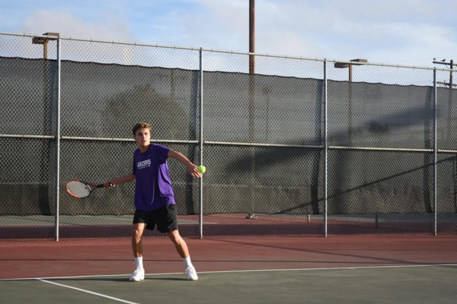 Sophomore Noah Muniz returns the ball with a forehand winning the point against his  competitor. Carlsbad went on to win their first preseason game  against Classical Academy.