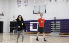 Juniors Alex Roberts and Sophia Zhao warm up with a quick rally at Badminton Club. The club regularly meets in the old gym to play badminton and have fun.