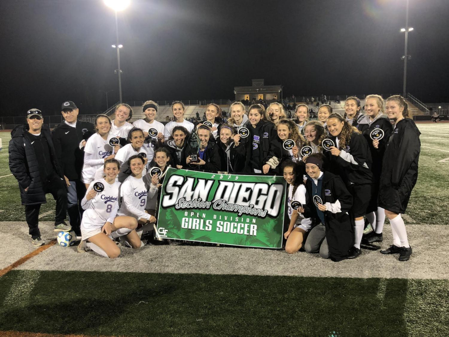 Varisty girls soccer poses with their Open Division trophy and banner. The game finished 1-0 Lancers with a goal from sophomore Lexi Wright in the second half.