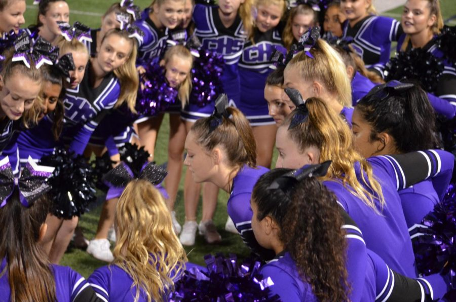 Cheer+Leaders+huddle+up+at+9%2F20+football+game+against+San+Marcos+high.+While+huddling+up%2C+spectators+can+hear+their+cheer.++