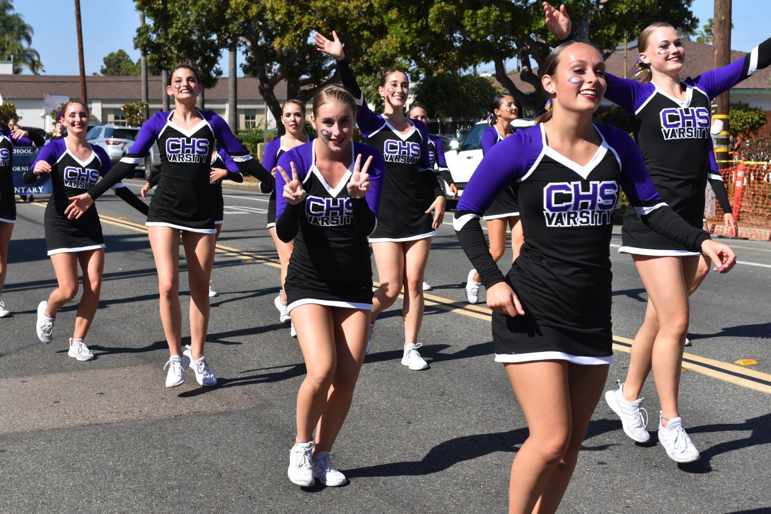 Lancer Dancers dance through the streets of down town Carlsbad, with Senior Maddie Dufault leading the charge. The Lancer Dancers perform tirelessly through the whole parade.