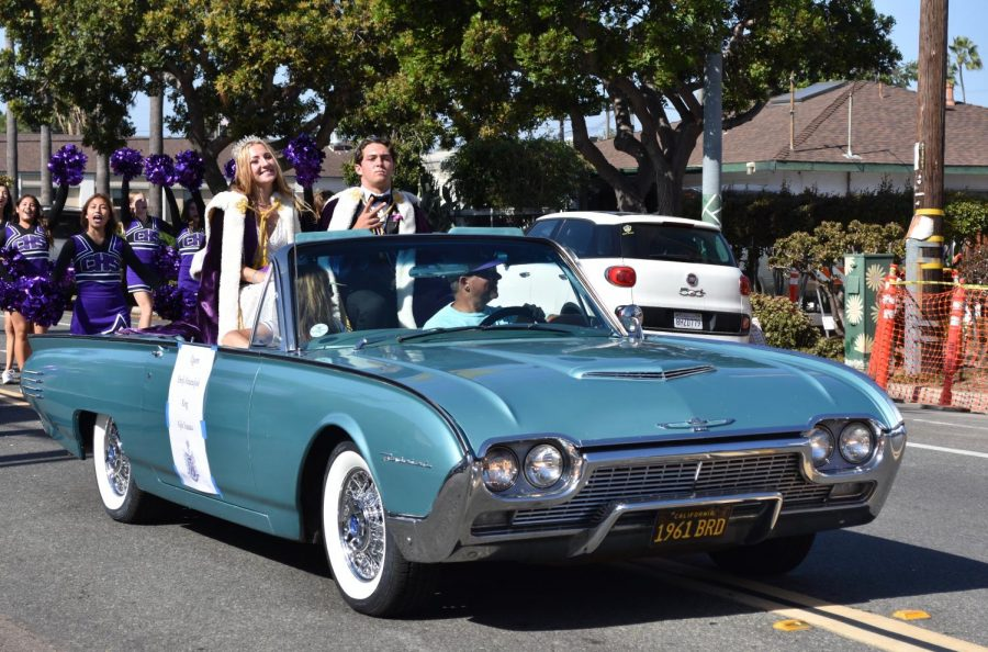 Seniors Emily Kraszulyak and Kyle Vassau ride around as  homecoming queen and king.  They were one of five couples selected to be on the court.