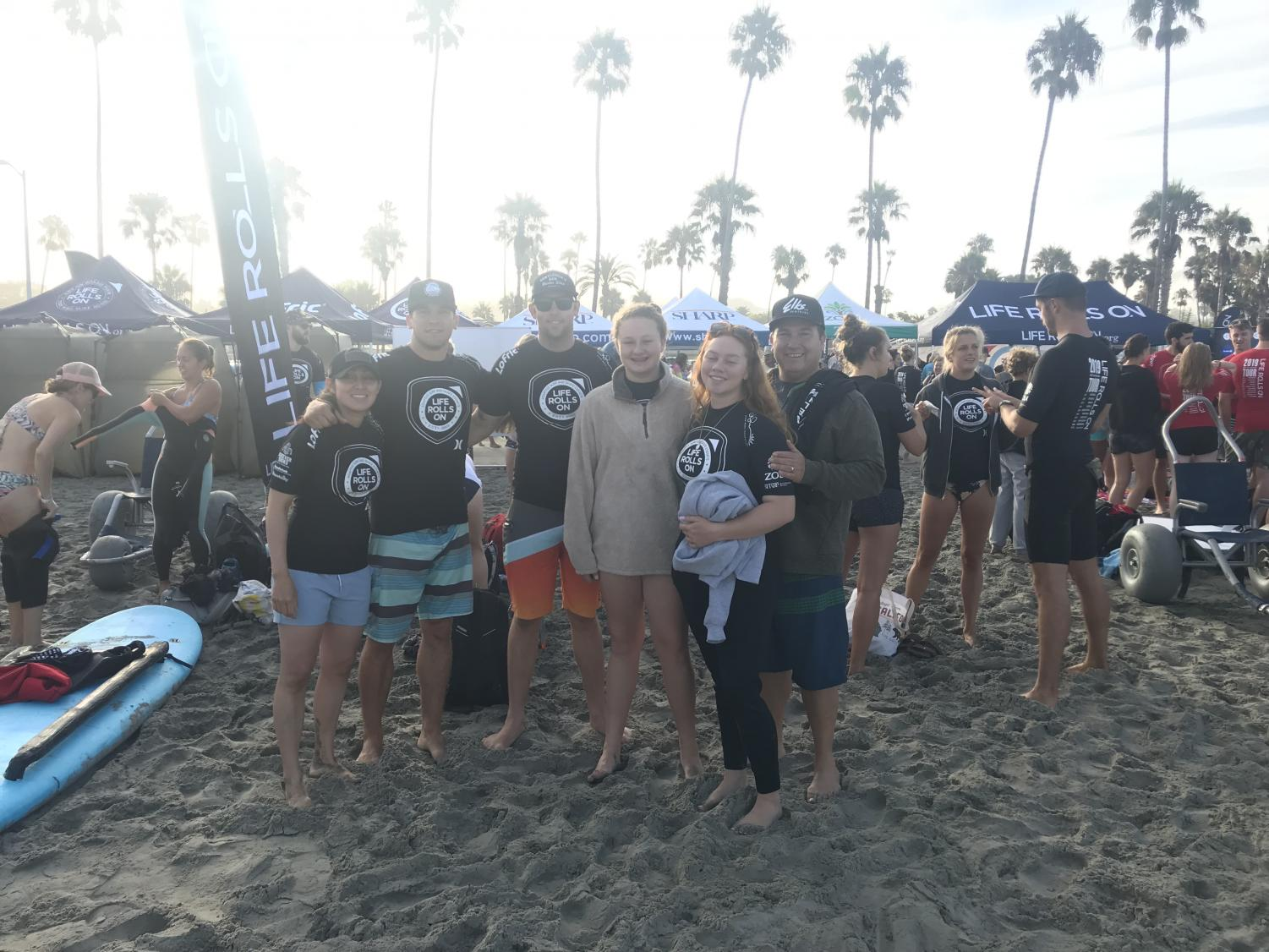 The Reyes family gathers with big smiles to capture the moment at the Life Rolls on event. The surf event took place on September 22, 2019.