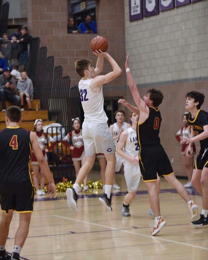 Caleb Nelson, 11, plays basketball against Torrey Pines last season.