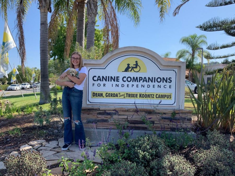 Hansen poses with her dog, Isley, in front of CCI premises.