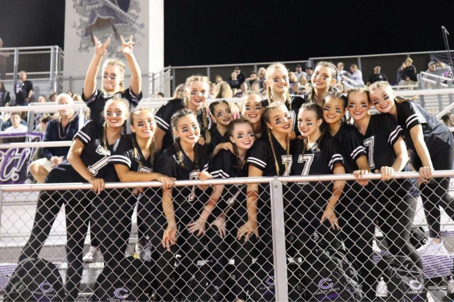Lancer Dancers crowd together after finishing the half-time performance at the first football game of the year. It was Fuchs' first game as a Lancer Dancer.