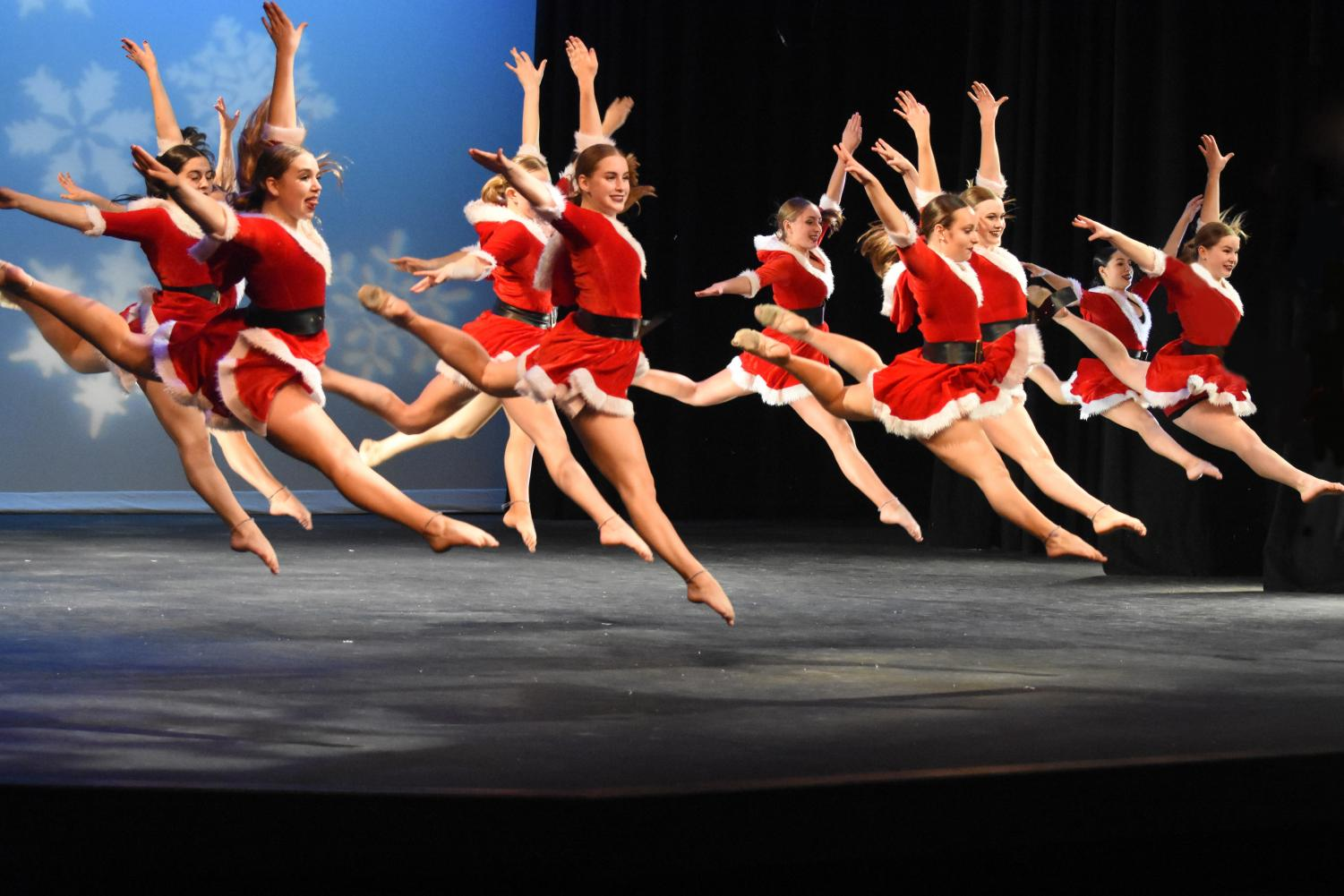 The Lancer Dancers leap as they perform a Christmas themed dance for their showcase. Showcase is their major source of funds to get them to nationals.