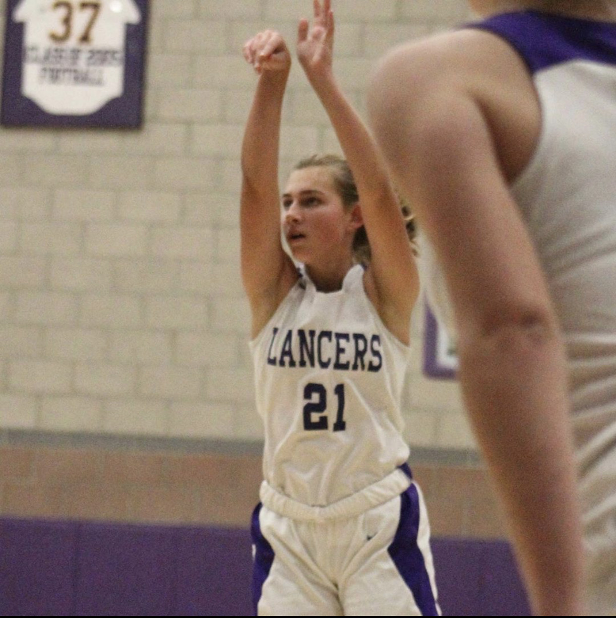 Freshman, Madison Huhn shoots the ball. The girls basketball season has just recently started up in early December.