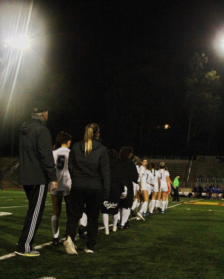 The+varsity+girls+soccer+team+lines+up+to+shake+hands+with+their+opponents.+The+team+beat+San+Pasqual+11-0+in+their+season+opener.%0APhoto+courtesy+of+%40chs_wsoccer