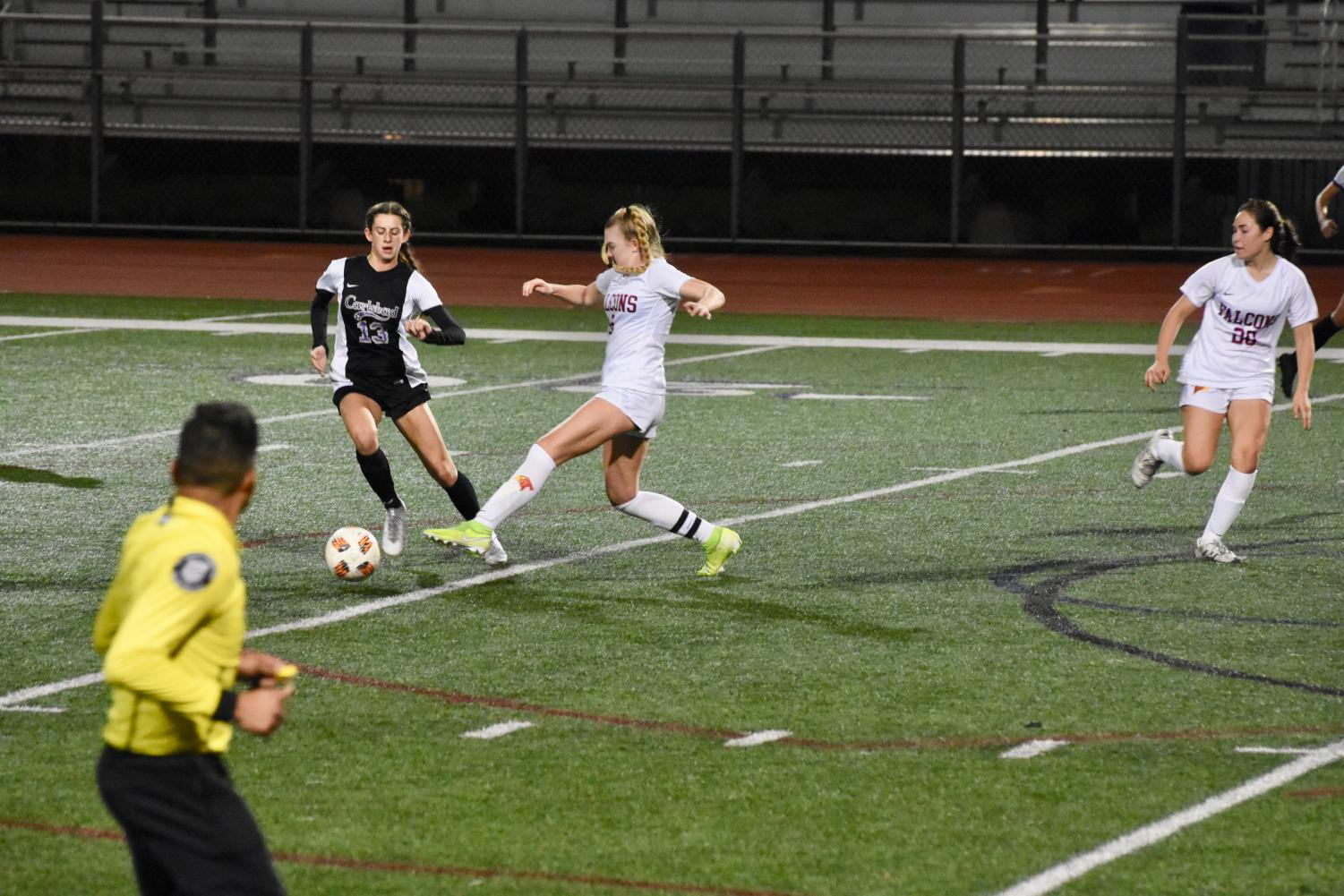 Junior Lexi Wright runs through the Torrey Pines defense as she tries to score. The varsity girls team got the win against Torrey with an end score of 2-1.