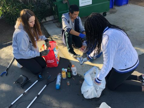 Lu and club members sort out recyclables from trash after spending an hour of cleaning litter around Carlsbad.