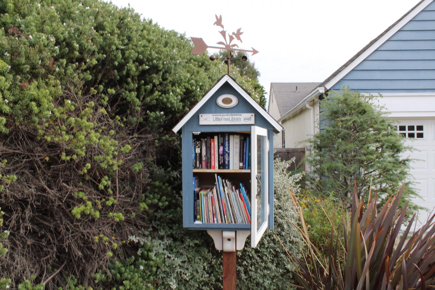 """Joanne Martinez's book exchange location stands in front of the house it was modeled after. The successful impact of Martinez's Little Free Library allowed her to help other book exchanges in the community. """"We have an excess number of books,"""" Martinez said. """"We will oftentimes put them all in a box and go and drop them off at someone else's little library to share."""""""