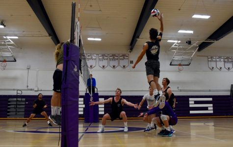 Photo of the week 2/16 the boys volleyball team battles against the alumni