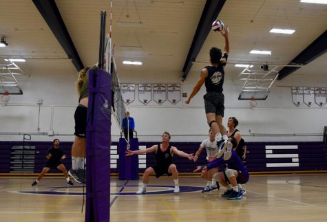 Senior Derek Valdez leaps in order to spike the ball against the alumni. Valdez was key in order to secure the teams victory against the alumni.
