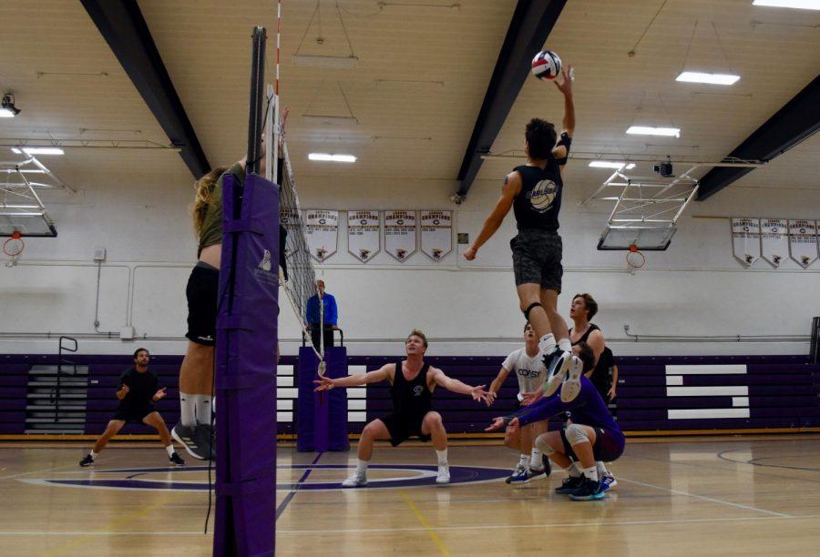 Senior Derek Valdez leaps in order to spike the ball against the alumni. Valdez was key in order to secure the teams victory against the alumni.