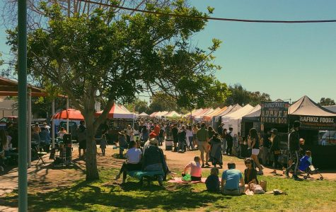 Between 10am and 2pm on Sundays, family and friends walk along the stalls of the Leucadia Farmers Market. Vendors sell items such as produce, meals, clothing and specialty goods.