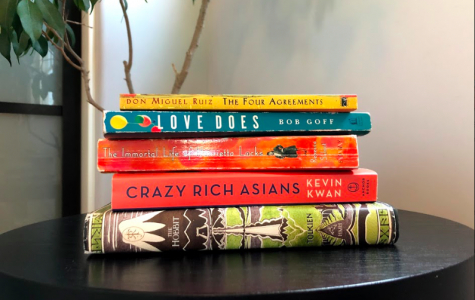 Books include The Hobbit, Crazy Rich Asians, The Immortal Life of Henrietta Lacks, Love Does and The Four Agreements. Photo by Natalie Landes.