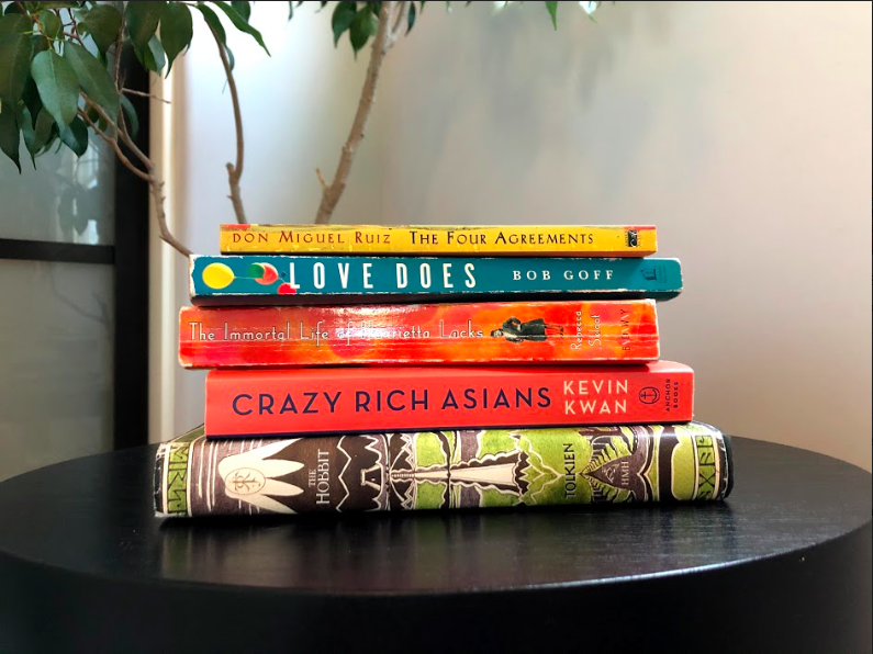 Books+include+The+Hobbit%2C+Crazy+Rich+Asians%2C+The+Immortal+Life+of+Henrietta+Lacks%2C+Love+Does+and+The+Four+Agreements.+Photo+by+Natalie+Landes.