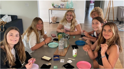 Students, including Grace Lauder, Kennedy Krebs and Kyndall Krebs, bead bracelets to raise money against human trafficking.