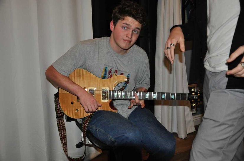 "Sophomore James Sullivan playing a ""Wolf"" guitar during a practice session with his band."