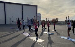 The cheerleading team practicing on campus in the recreational P.E. area
