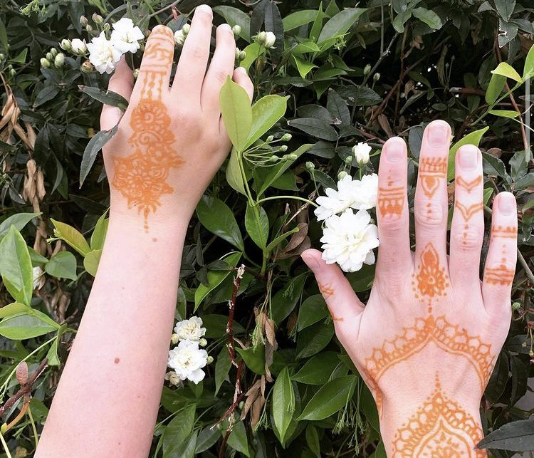 Hanson enjoys practicing henna on herself and others.