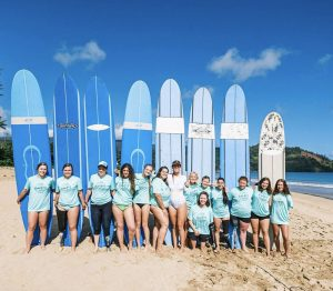 Girls from all walks of life join together on the beach at The Beautifully Flawed retreat. The girls participated in many different actives at the retreat including surfing.