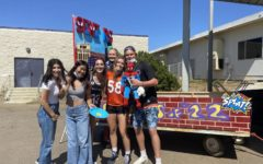 The senior class builds their Spiderman inspired float.