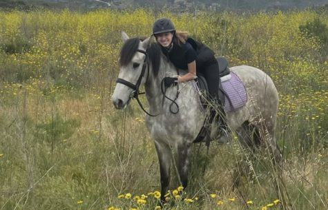 Avery Briones riding her project horse on a trail ride.