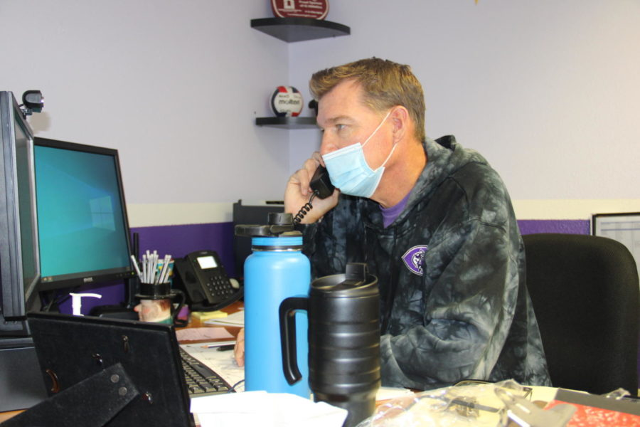 Athletic director Tom Bloomquist works in his office during the day and coaches womens volleyball in the afternoons.